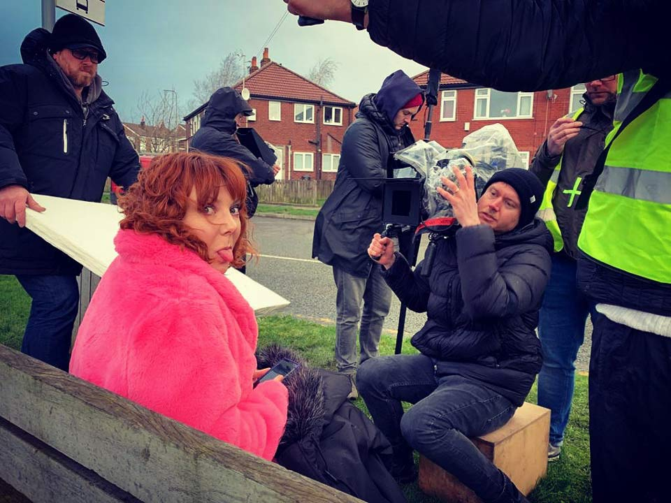 Sophie in pink coat on location filming Almas Not Normal