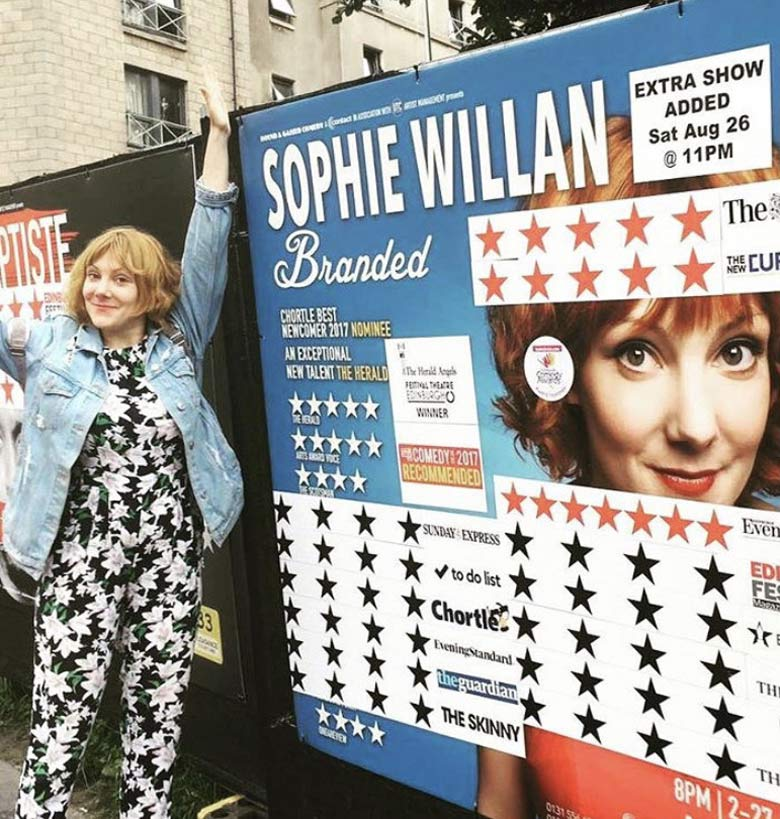 Sophie Willan beside a large poster of her Branded show