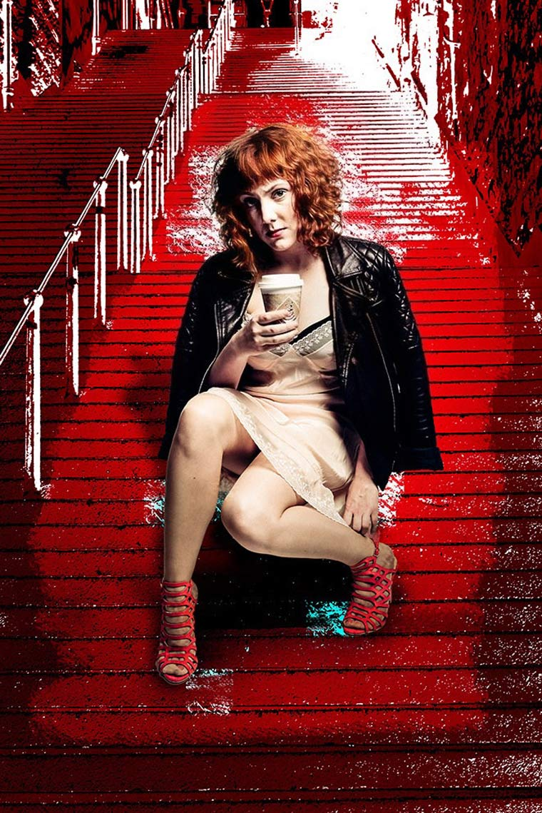 Sophie Willan sat on steps with a takeaway coffee cup